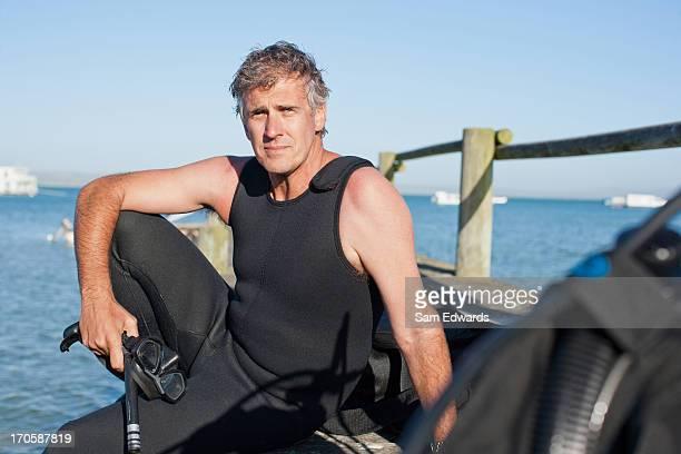 Man in scuba gear on pier