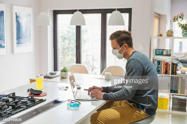 man in self isolation working from home - home office stock pictures, royalty-free photos & images