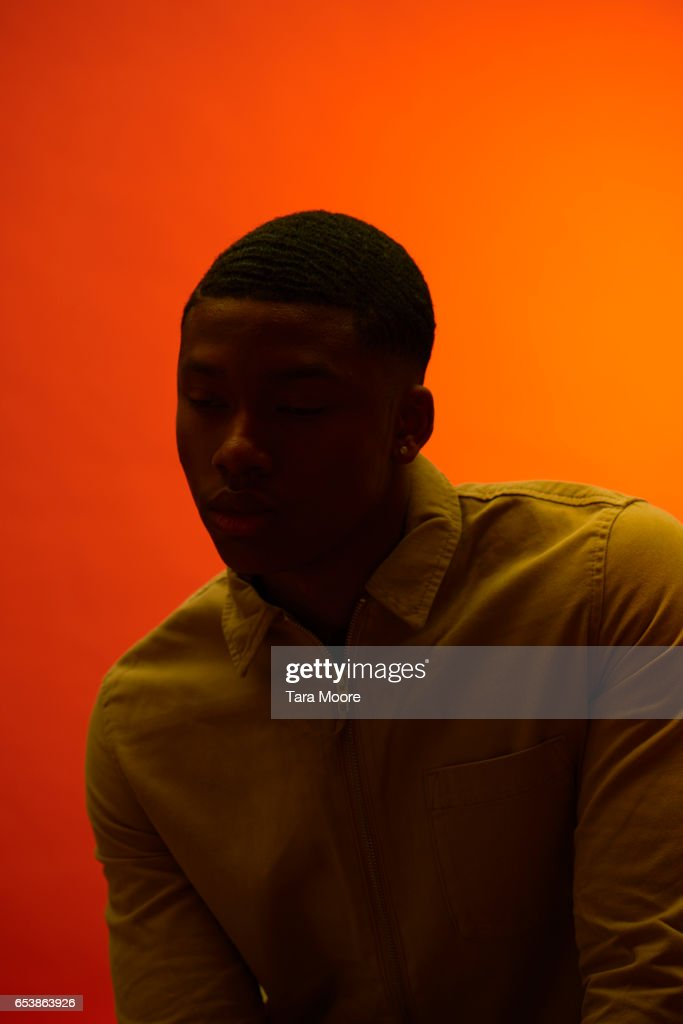 man in shadow with orange background : Stock Photo