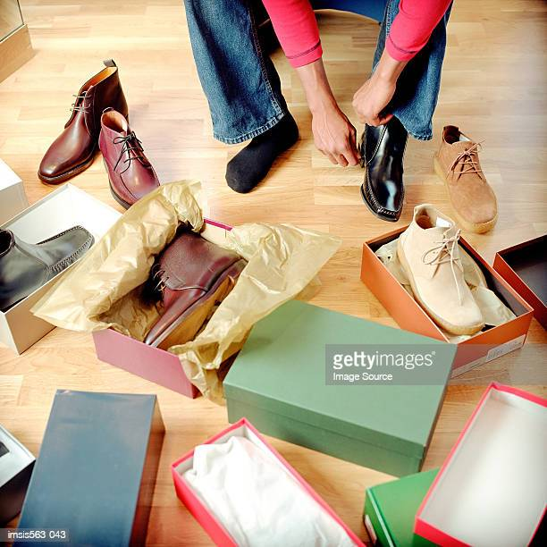 man in shoe store - shoe box stock pictures, royalty-free photos & images