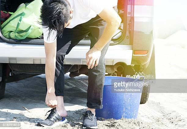 man in shoes - yusuke nishizawa stock pictures, royalty-free photos & images