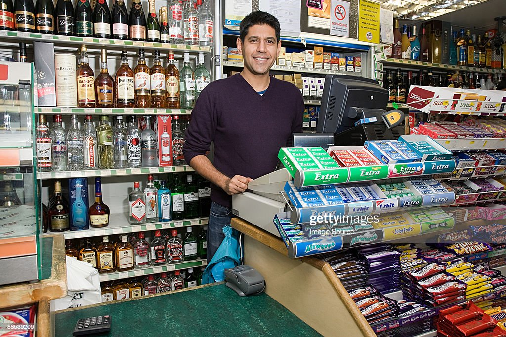 Man in shop : Stock Photo