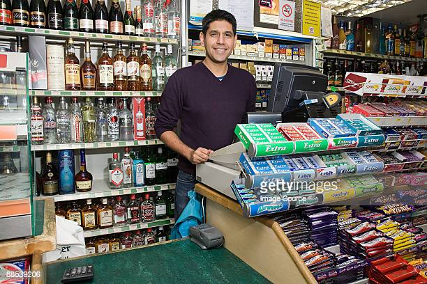 man in shop - convenience store stock photos and pictures