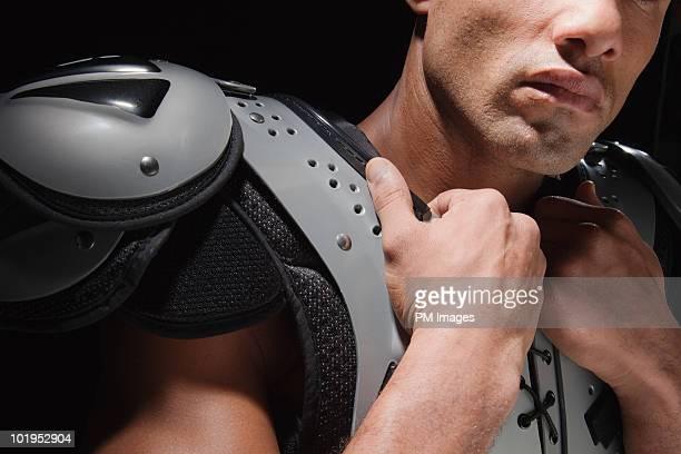Man in shoulder pads