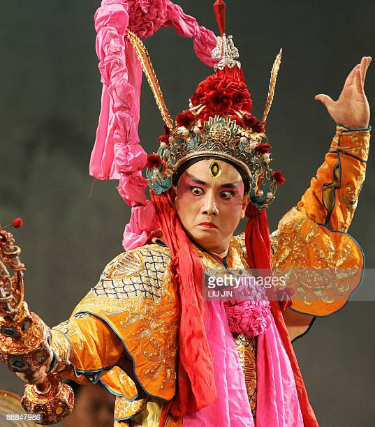 A man in Sichuan Opera costumes performs in the Golden Hill Temple during a performance as part of the International Festival of Intangible Culture...