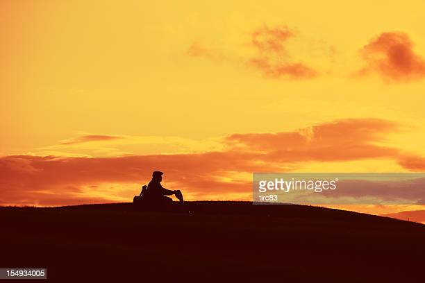 man in silhouette on mobility scooter - mobility scooter stock photos and pictures