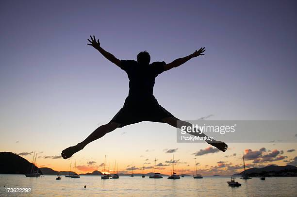 Man in Silhouetted Spreadeagled Sunset Leap