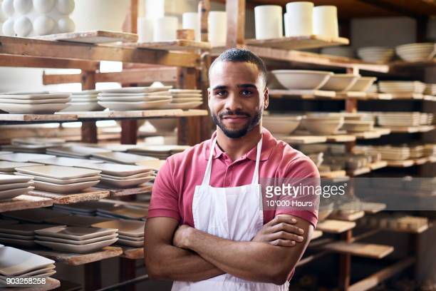 man in small pottery factory - business owner stock photos and pictures