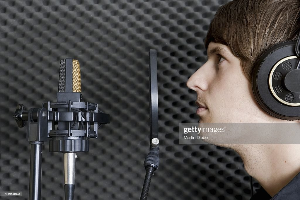 Man in sound booth of recording studio : Stock Photo