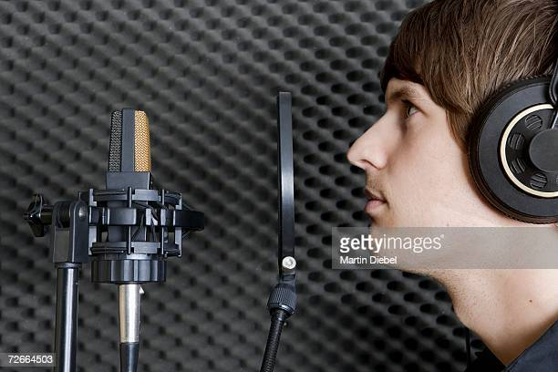 man in sound booth of recording studio - sound recording equipment stock pictures, royalty-free photos & images