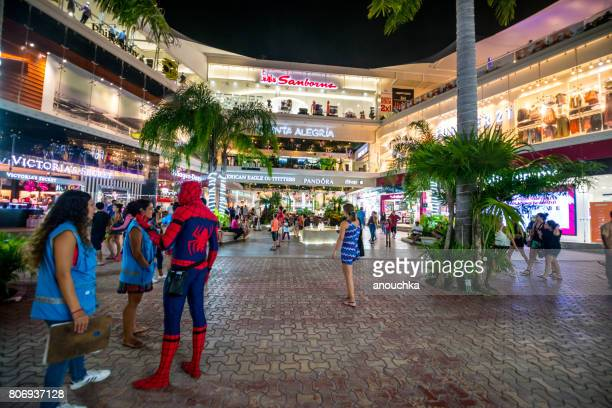 Man in Spiderman costume on 5th Avenue, shopping street in Playa del Carmen, Mexico