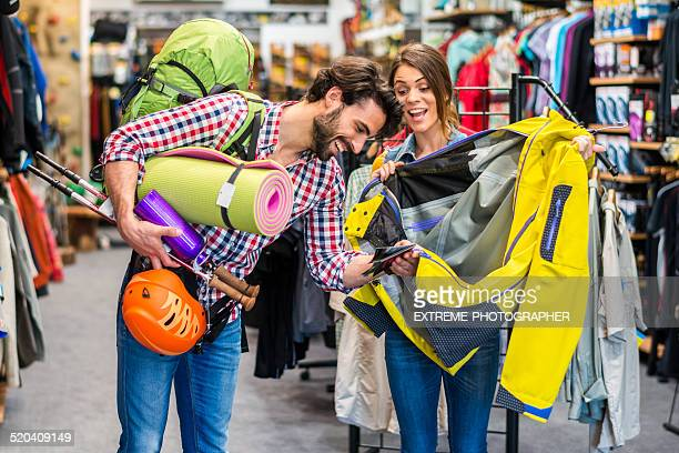 Man in sports store buying outdoor equipment