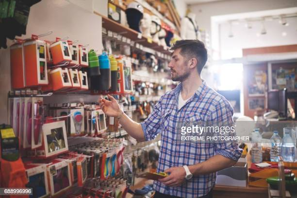 man in sports store - megastore stock photos and pictures