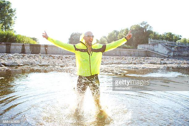 man in sports wear cheering in water - best sunglasses for bald men stock pictures, royalty-free photos & images