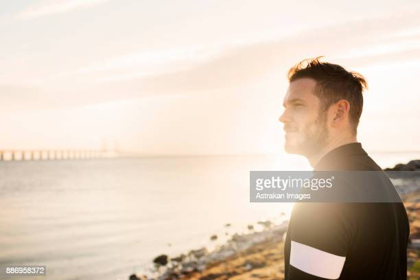Man in sportswear looking at view