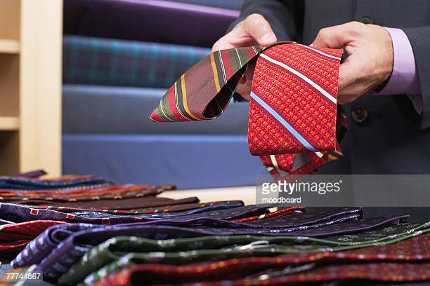 Man in Store Shopping for Neckties