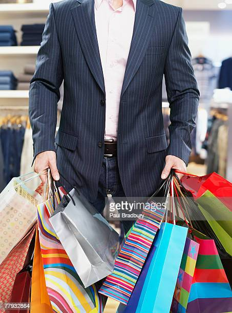 Man in store with shopping bags