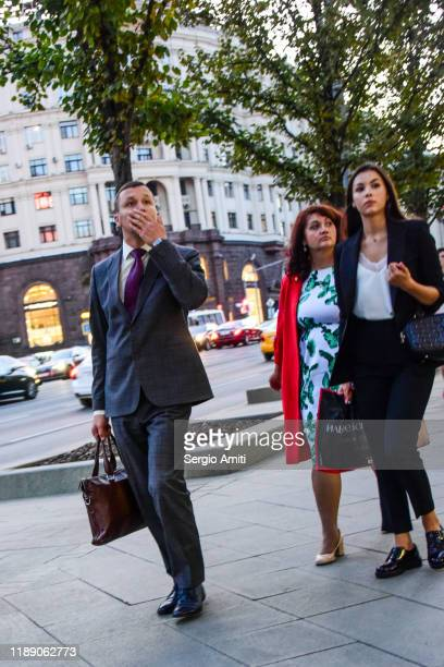 man in suit and two women in business clothes in moscow - sergio amiti stock pictures, royalty-free photos & images