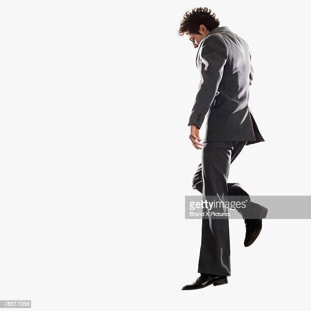 Man in suit dancing