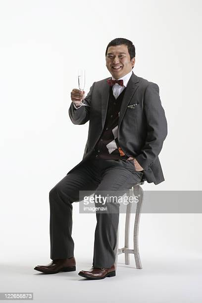 a man in suit holding a glass - metabolic syndrome stock pictures, royalty-free photos & images