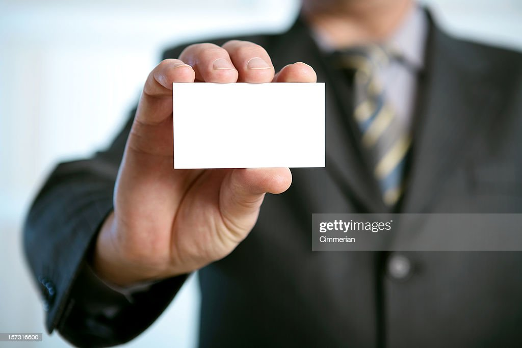 Man In Suit Holding Blank Business Card In A His Hand Stock Photo ...