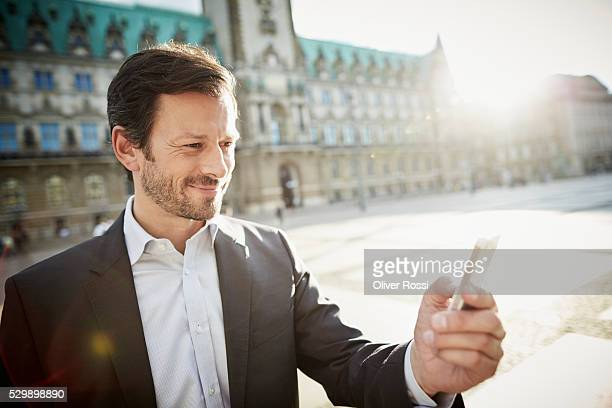 Man in suit holding cell phone