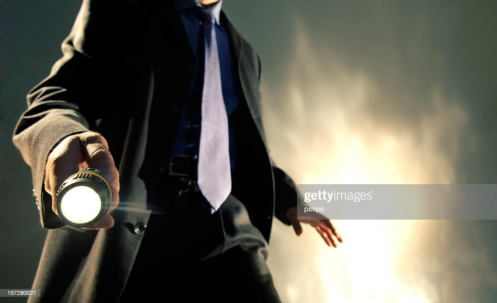 Man in Suit Holding Torch : Stock Photo