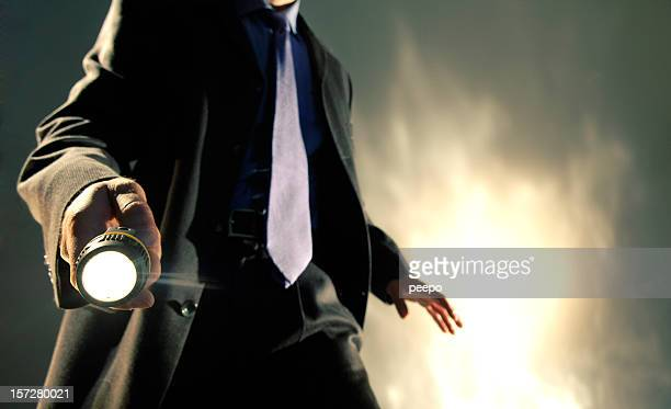 man in suit holding torch - detective stock pictures, royalty-free photos & images