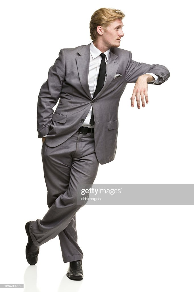 Man in Suit Leans Against Nothing : Stock Photo