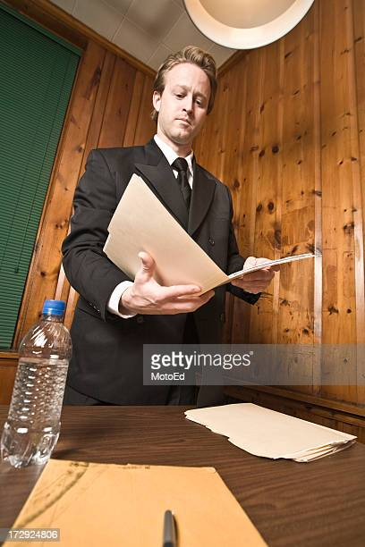Man in Suit - Looking over file