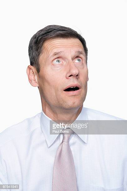 Man in suit looking up and sideways