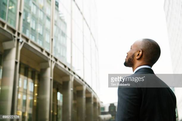man in suit looking up - chance stock pictures, royalty-free photos & images