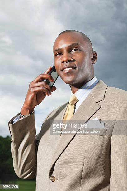 man in suit on cell phone