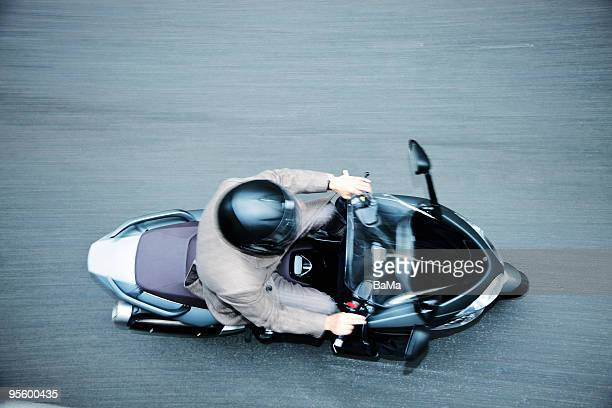 man in suit riding moped - moped stock photos and pictures