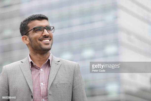 man in suit smiling in city - middle east stock pictures, royalty-free photos & images