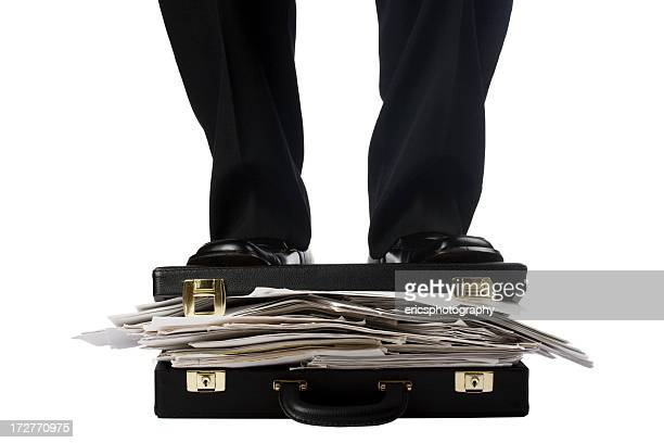Man in suit standing on documents