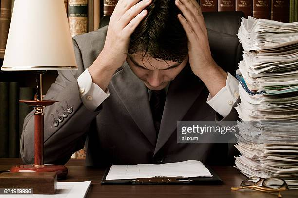 Man in suit stressed by work