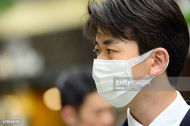 Man in suit wearing face mask