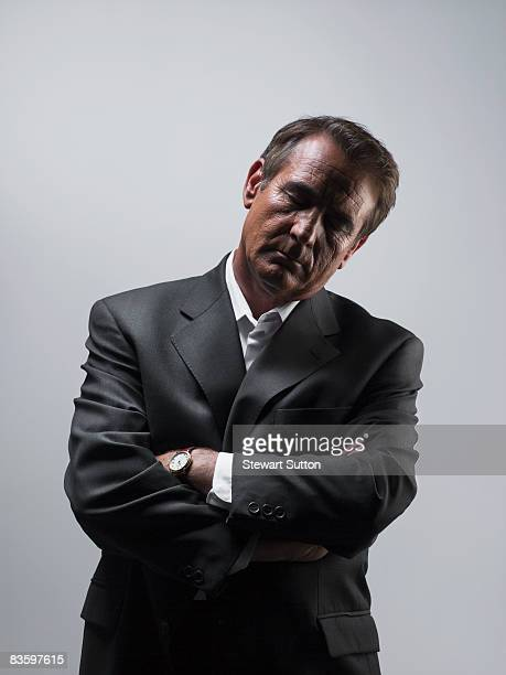 man in suit with eyes closed