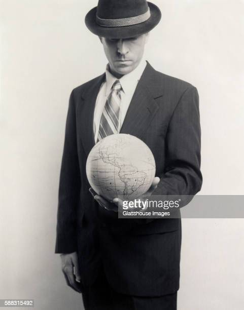 Man in Suit with Globe