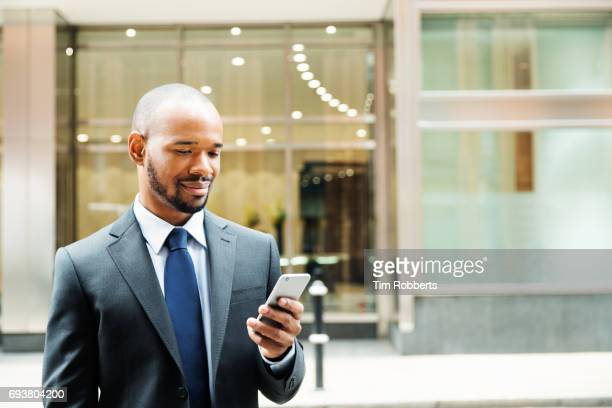 Man in suit with smart phone