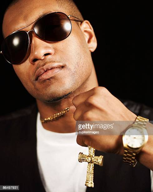 Man in sunglasses with gold cross