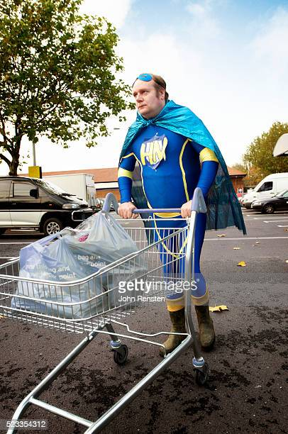Man in Superhero Costume Pushing Grocery Cart