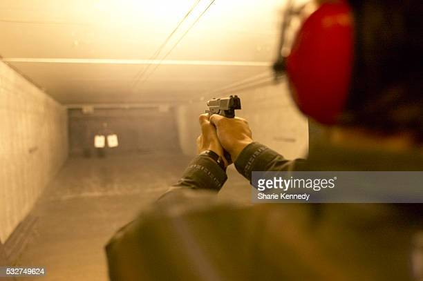 man in target practice - ターゲット射撃 ストックフォトと画像