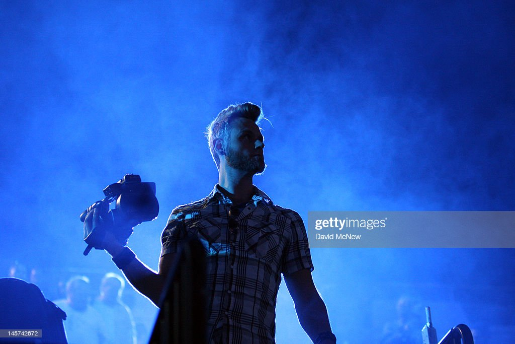A man in the audience holds a video camera during the Sony press conference on the eve of the Electronic Entertainment Expo (E3) on June 4, 2012 in Los Angeles, California. E3 is the most important yearly trade show the $78.5 billion videogame industry.