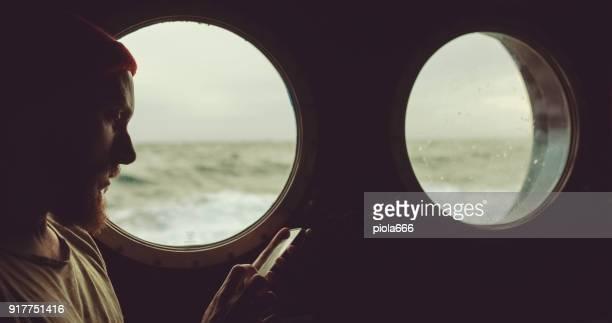 Man in the cabin of a sailing vessel