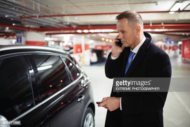 man in the car - car alarm stock photos and pictures