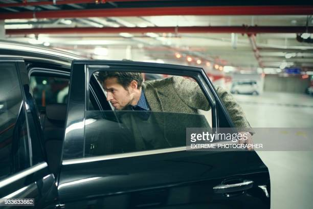 man in the car - entering stock pictures, royalty-free photos & images
