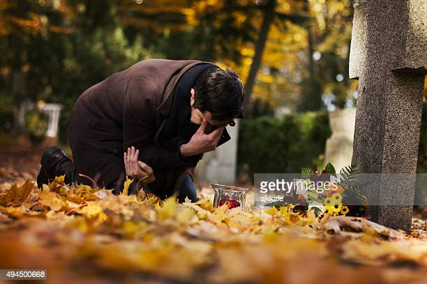 man in the cemetery - crosses with flowers stock pictures, royalty-free photos & images