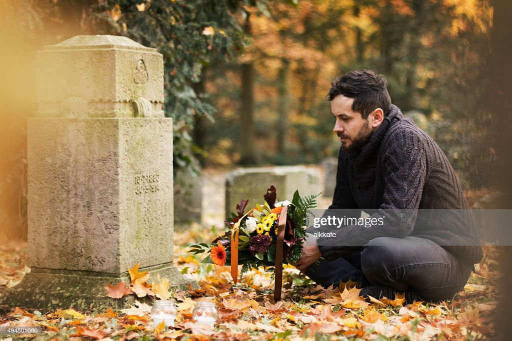 Man in the cemetery : Stock Photo